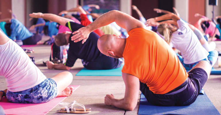 middle aged man in a yoga class