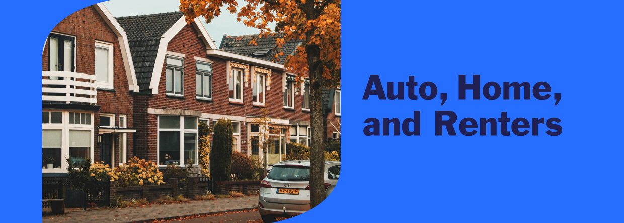 Red brick houses and a car in a neighborhood in fall